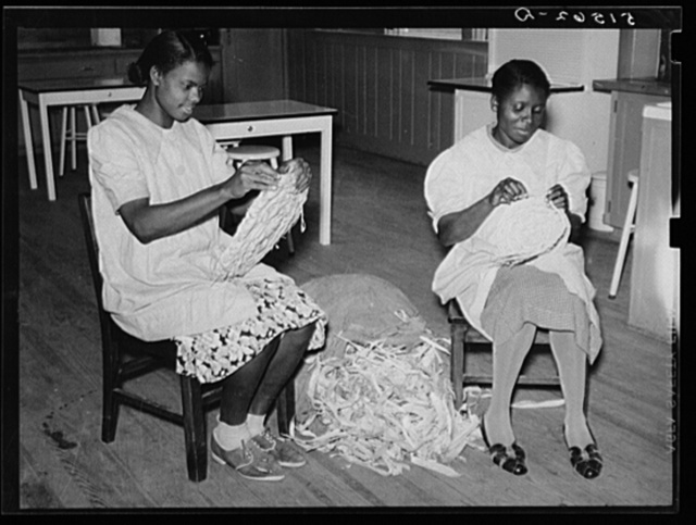 NYA (National Youth Administration) girls making mats from cornshucks in home economics room. Gee's Bend, Alabama