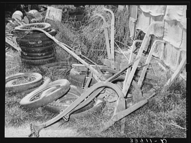 Old plows and wornout tires. Testimonial to the sources of the residents of the community camp. Oklahoma City, Oklahoma. See general caption no. 21