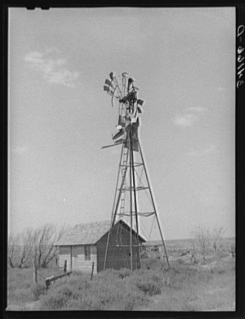 Old windmill and shed on abandoned farm near Syracuse, Kansas