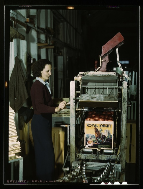 Operating a machine for putting tops on crates at a co-op orange packing plant, Redlands, Calif. Santa Fe R.R. trip