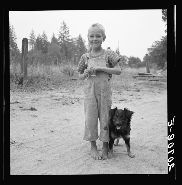 Oregon. Josephine County, near Grants pass. Migrant boy, family, live in grower's camp for hop season. See general caption number 45