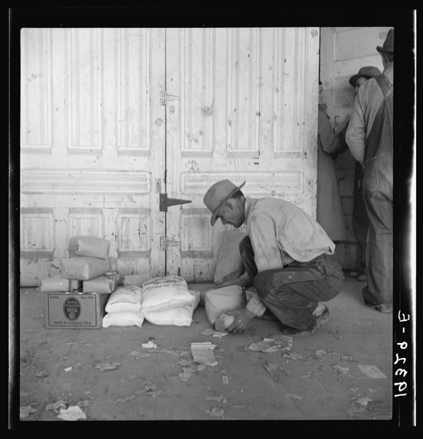 Outside the Farm Security Administration (FSA) grant office during pea harvest. Calipatria, California. During the spring of 1938 for the first time the labor surplus has grown so large that relief grants were necessary even during the peak of harvest