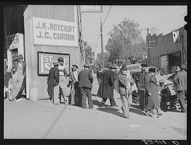 Outside tobacco warehouse during auction sales. Durham, North Carolina