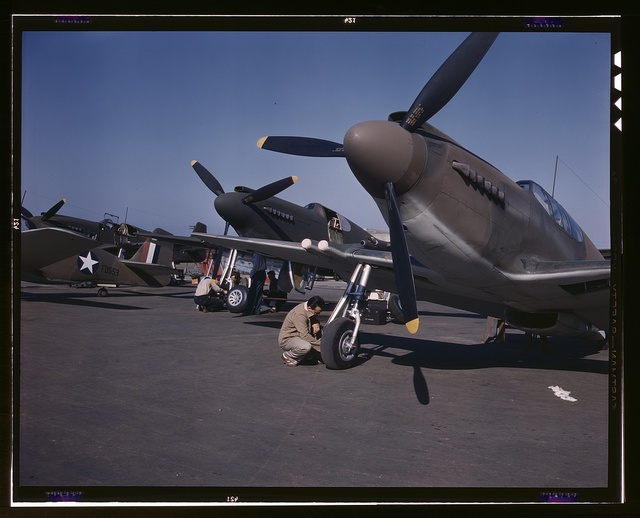 "P-51 (""Mustang"") fighter planes being prepared for test flight at the field of North American Aviation, Inc., plant in Inglewood, Calif."
