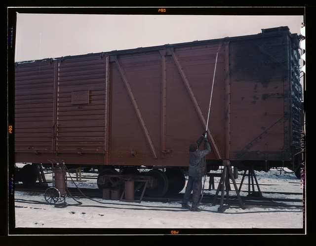 "Painting a car at the repair or ""rip"" tracks at North Proviso(?), C & NW RR., Chicago, Ill."