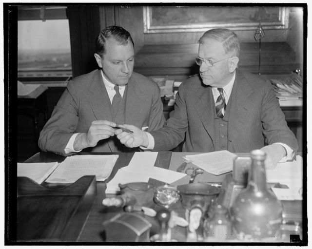 Pan American given permission to use Canton Island as air base. Washington, D.C., April 13. Following an agreement between the United States and Great Brittan for the common use of the Island of Canton and Enderbury in the South Pacific Ocean for international aviation and communication, Secretary of interior Harold Ickes today signed a license permitting Pan American Airways to use Canton Island as an air base for its commercial trans-Pacific air transport service between California and New Zealand. Secretary Ickes is show presenting the pen to Juan Trippe, President of Pan American, after the signing. 4-13-39