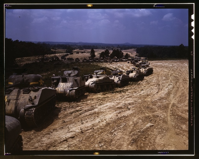 Parade of M-4 (General Sherman) and M-3 (General Grant) tanks in training maneuvers, Ft. Knox, Ky. Note the lower design of the M-4, the larger gun in the turret and the two hatches in front of the turret