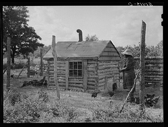 Pauline Clyburn, rehabilitation client at Manning, Clarendon County, South Carolina, with chicken house she made herself. The window she took from her own bedroom