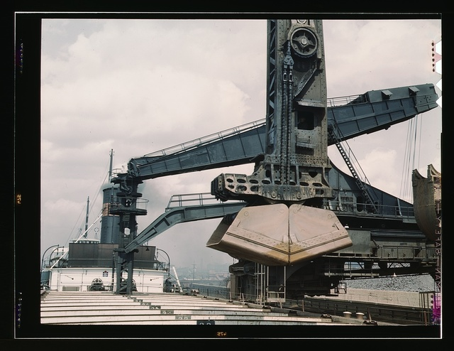 """Pennsylvania R.R. ore docks, unloading iron ore from a lake freighter by means of """"Hulett"""" unloaders, Cleveland, Ohio"""
