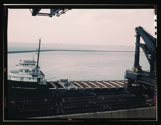 "Pennsylvania R.R. [Railroad] ore docks, unloading iron ore from a lake freighter by means of ""Hulett"" unloaders, Cleveland, Ohio"