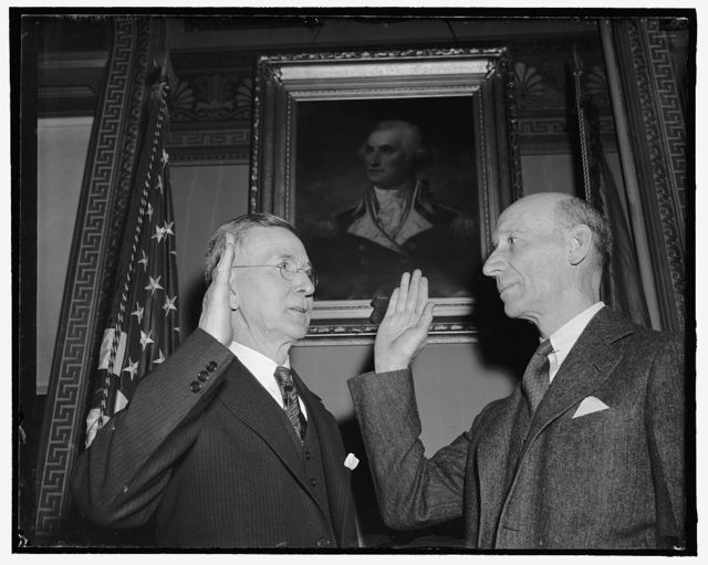 Pershing long-time aide promoted to rank of Colonel. Washington, D.C., March 30. Capt. George E. Adamson, left, Quartermaster Corps, U.S. Army, whose nomination as Military Secretary to the General of the Armies with the rank of Colonel was confirmed by the Senate today, is pictured taking the oath as administered by Maj. Gen. Emory C. Adams, Adjutant General. Col. Adamson has been Military Secretary to General Pershing for approximately 23 years, including the periods of the punitive expedition into Mexico, the World War, and the period subsequent to the World War. 3-30-39