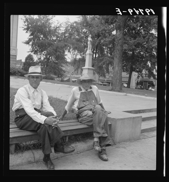 Person County. Farmer in town idling around the county courthouse. Note Confederate monument characteristic of Southern towns. Roxboro, North Carolina