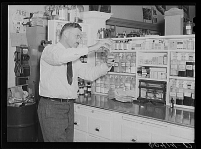 Pharmacist filling prescription. Graceville, Minnesota