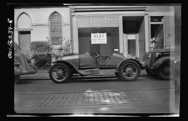 Philadelphia, Pennsylvania. A rebuilt jalopy parked on Pine Street
