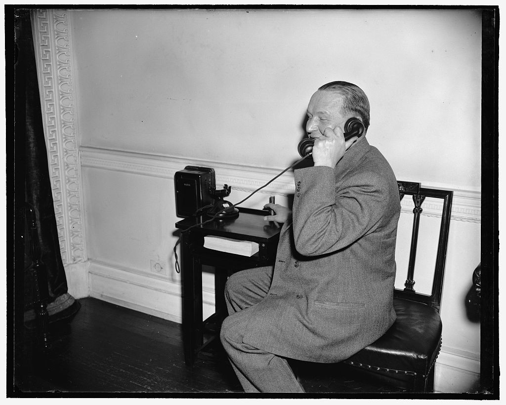 Phones boss. Washington, D.C., March 20. Kurt G. Sell, Washington Correspondent for the German News Bulletin, phones in his story of Undersecretary of State Sumner Welles' press conference today. A highlight of the conference was the announcement that American Minister Wilbur Carr had been instructed to close the U.S. Legation in Prague and turn over the properties and records to the American Consul General, 3-20-39