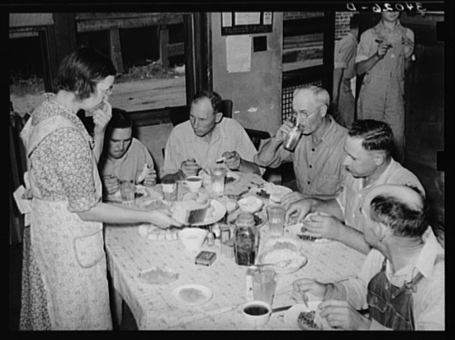 Pickets of striking oil workers' union eating lunch prepared by their wives at union headquarters. Seminole, Oklahoma