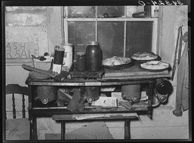 Pies, canned goods and household articles on stove in farm home. Bradford, Vermont, Orange County