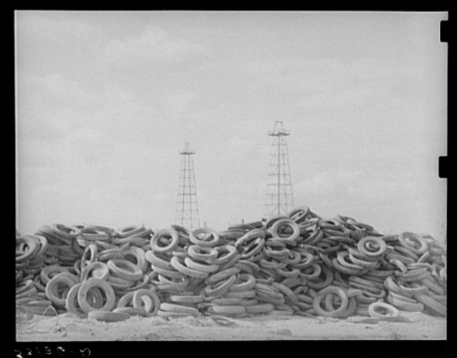Piles of worn-out automobile tires in oil fields at Kilgore, Texas. Bad roads and heavy trucking in the oil fields cause great wear on both tires and automobiles