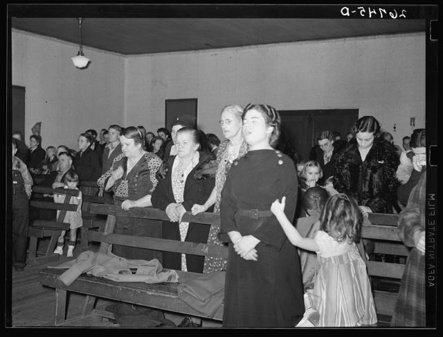 Praying during revival meeting. Pentecostal church, Cambria, Illinois