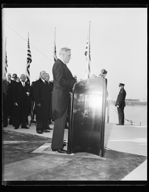 PRESIDENT EULOGISES JEFFERSON'S POLITICAL IDEALS AT CORNERSTONE LAYING. WASHINGTON, D.C. NOVEMBER 15. SPEAKING TODAY AT THE FORMAL LAYING OF THE CORNERSTONE OF THE UNFINISHED MEMORIAL TO THOMAS JEFFERSON HERE, PRESIDENT ROOSEVELT PRAISED THE POLITICAL FUNDAMENTALS LAID DOWN BY THE THIRD PRESIDENT. 'HE LIVED AS WE LIVE IN THE MIDST OF STRUGGLE BETWEEN RULE BY THE SELF-CHOSEN INDIVIDUAL OR THE SELF- APPOINTED FEW, AND RULE BY THE FRANCHISE AND APPROVAL OF THE MANY,' HE SAID. DIGRESSING FROM HIS PREPARED SPEECH AT THE OUTSET, HE SAID, '...I HOPE THAT BY JANUARY OF 1941 I SHALL BE ABLE TO COME TO THE DEDICATION OF THE MEMORIAL ITSELF.' HIS TERM DOES NOT EXPIRE UNTIL JANUARY 20, 1941
