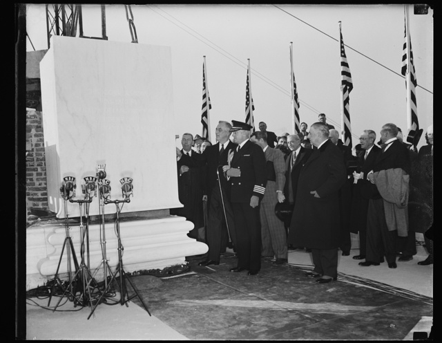 PRESIDENT LAYS CORNERSTONE OF NEW JEFFERSON MEMORIAL. PRESIDENT ROOSEVELT LAYING THE CORNERSTONE OF THE NEW JEFFERSON MEMORIAL ON THE BANKS OF THE POTOMAC RIVER. THE EDIFICE WHEN COMPLETED WILL HAVE COST $13,000,000. WITH THE PRESIDENT IS CAPT. DANIEL CALLAGHAN, WHITE HOUSE NAVAL AIDE