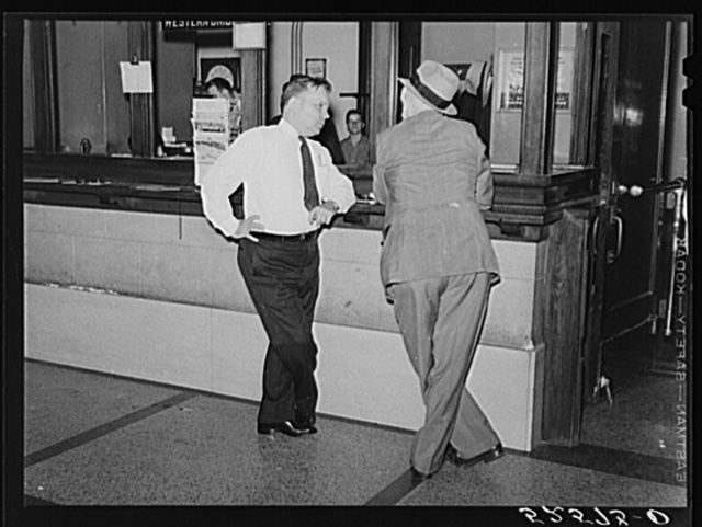 President of Memphis cotton exchange discussing business with one of the members on the floor