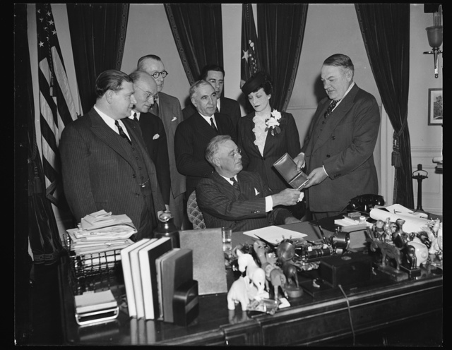 PRESIDENT PRESENTED WITH AMERICAN HEBREW MEDAL. WASHINGTON, D.C. MARCH 6. PRESIDENT ROOSEVELT WAS TODAY PRESENTED WITH THE AMERICAN HEBREW MEDAL FOR THE PROMOTION OF BETTER UNDERSTANDING BETWEEN CHRISTIAN AND JEW IN AMERICA. IN MAKING THE PRESENTATION, GEN. HUGH S. JOHNSON, A MEMBER OF THE COMMITTEE OF AWARD, CHARACTERIZED THE PRESIDENT AS THE MOST DISTINGUISHED CHAMPION OF DEMOCRACY 'IN THIS DANGEROUS WORLD.' IN THE PHOTOGRAPH, L TO R: JOSEPH H. BIBEN, EDITOR AND PUBLISHER OF AMERICAN HEBREW; REP. EMMANUEL CELLER OF NY; PROF. DANIEL CASEY OF GEORGETOWN UNIVERSITY; DR. MEYER JACOBSTEIN OF MEDAL AWARD COMMITTEE; ALLAN DINABURG; MRS. MAURICE GOLDMAN, NATIONAL PRESIDENT, COUNCIL OF JEWISH WOMEN IN AMERICA; AND GEN. HUGH S. JOHNSON