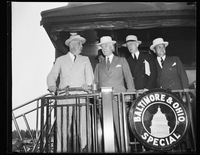 PRESIDENT RETURNS TO WASHINGTON. WASHINGTON, D.C. AUGUST 24. ON HIS RETURN TO WASHINGTON TODAY FROM A CRUISE IN NORTHERN WATERS, PRESIDENT ROOSEVELT WAS MET BY SECRETARY OF STATE HULL, UNDERSECRETARY OF STATE SUMNER WELLES, AND ASSISTANT SECRETARY OF STATE SUMNER WELLES, AND ASSISTANT SECRETARY OF WAR LOUIS JOHNSON. L TO R: ROOSEVELT, HULL, WELLES, JOHNSON