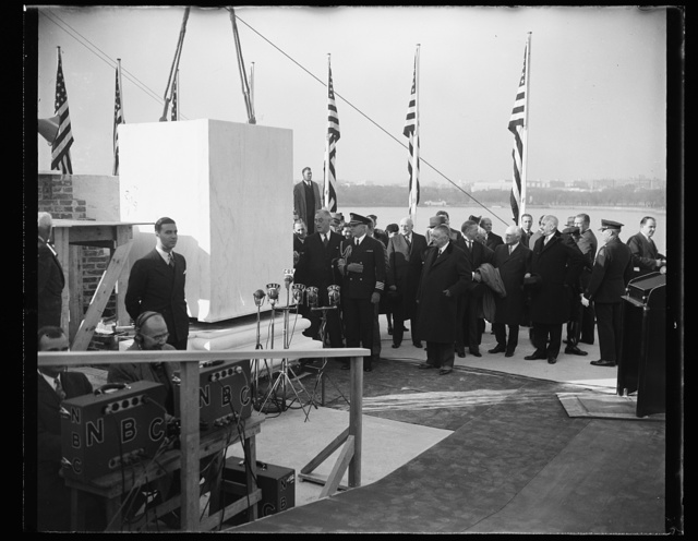 PRESIDENT ROOSEVELT LAYS BLOCK 208 AT THOMAS JEFFERSON MEMORIAL. WASHINGTON, D.C. NOVEMBER 15. PRESIDENT ROOSEVELT TODAY LAID THE CORNERSTONE AT THE UNFINISHED $3,000,000 THOMAS JEFFERSON MEMORIAL. TO THE STONECUTTER WHO MADE THE STONE, IT WAS BETTER IDENTIFIED AS SIMPLY 'NUMBER 208.' PHOTO SHOWS THE PRESIDENT AS HE WEILDED TROWEL HANDED DOWN THROUGH GENERATIONS SINCE GEORGE WASHINGTON