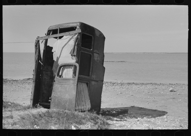 Privy made of old automobile bodies, Nueces Bay, Corpus Christi, Texas. Migrant camp