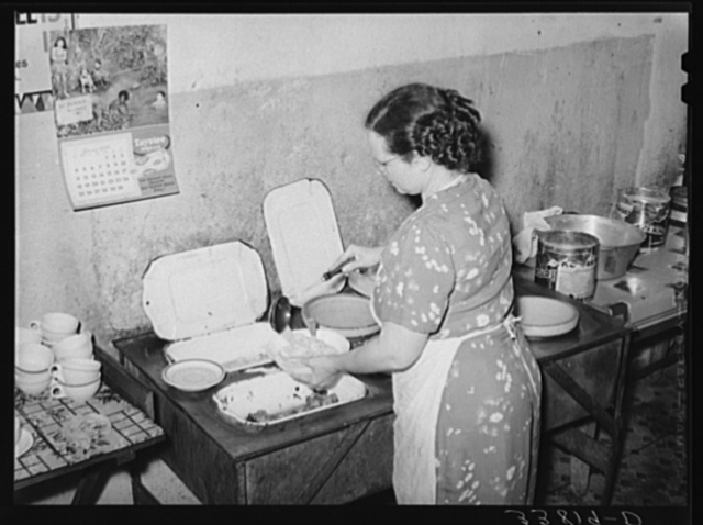 Proprietress of family style restaurant dishing up food. Muskogee, Oklahoma