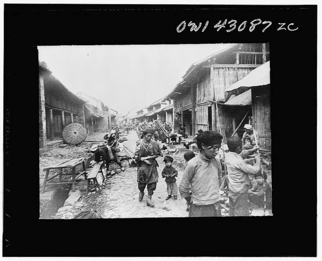 Public Health Service Investigation Commission to the China-Burma highway. A village street along the Burma road with a ditch running down the center. The anopheles minimus mosquito will not breed in this dirty water