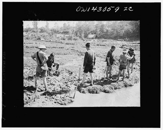 Public Health Service Investigation Commission to the China-Burma highway, Chefang (vicinity), China. Staking out and starting a seepage ditch in the Old Fort area