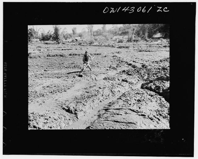 Public Health Service Investigation Commission to the China-Burma highway, Chefang (vicinity), China. Ditch digging in the mud, a slow process