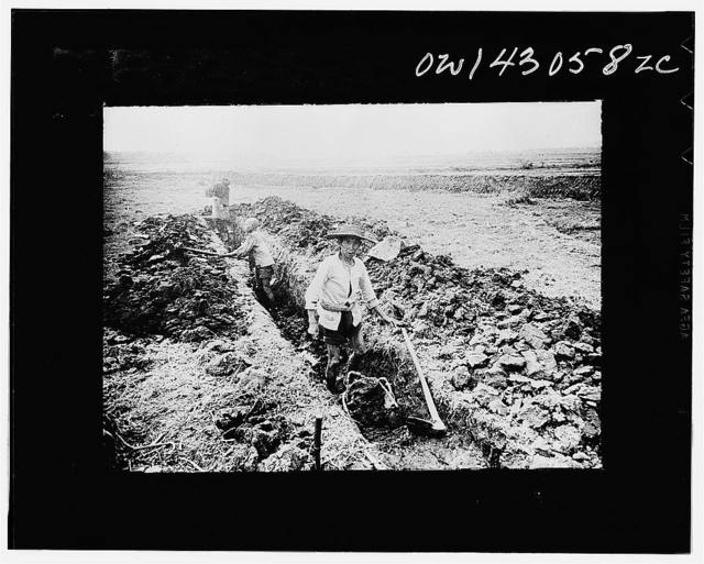 Public Health Service Investigation Commission to the China-Burma highway, Chefang (vicinity), China. Early stage in digging the seepage ditch in the Old Fort area