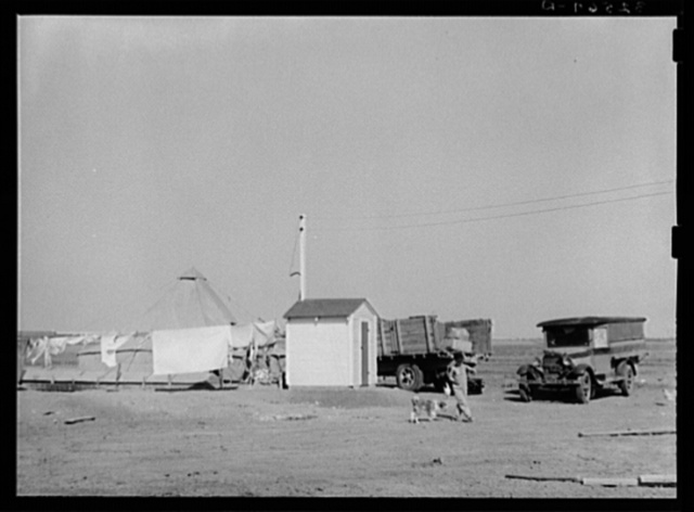 Pump house on farm. The camp of a brother who came to El Indio to look over the land before buying is also shown. Texas