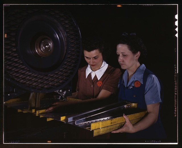 Punching rivet holes in a frame member for a B-25 bomber, the plant of North American Aviation, Inc., Calif.