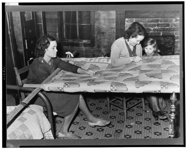 Quilting in sharecropper's home near Pace, Mississippi. Background photo for Sunflower Plantation