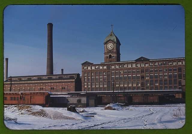 Railroad cars and factory buildings in Lawrence, Mass.