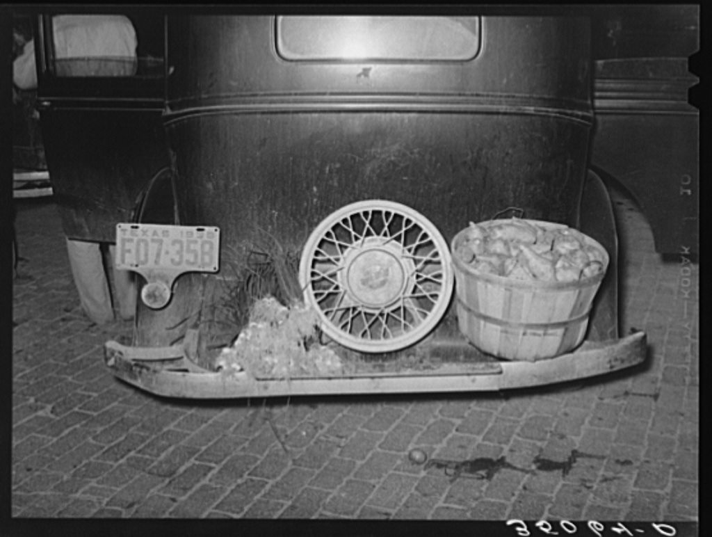 Rear of automobile of small grocer who has bought vegetables at the early morning market. San Angelo, Texas