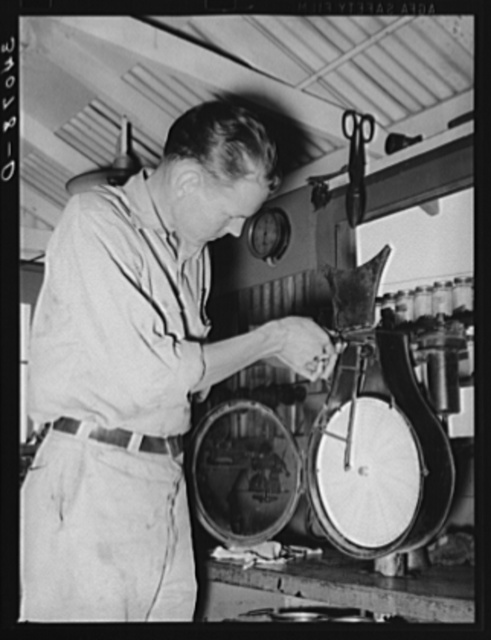 Recording thermometer repairman at oil refinery. Seminole, Oklahoma