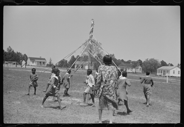 Rehearsing the maypole dance for May Day, health day excercises. Gees Bend, Alabama