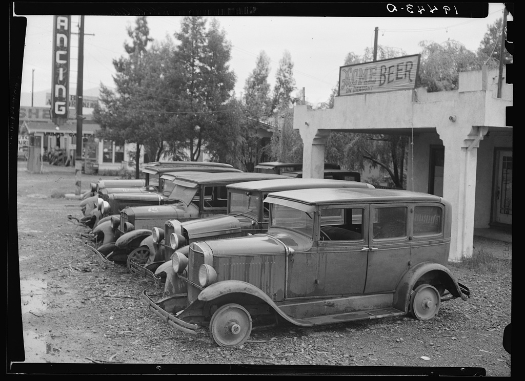 Roadside used car display on State Highway 17, in season when migrants come into region for pea-picking. Santa Clara County, California