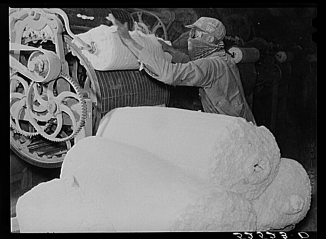 Rolls of lint from the cottonseed used in making of ammunitions and various cellulose products. Oil plant, Clarksdale, Mississippi Delta