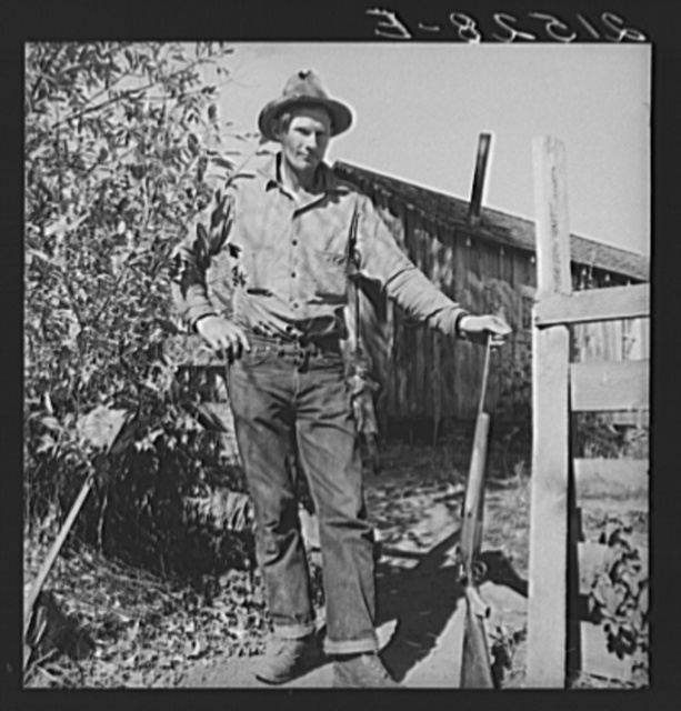 Roy Carlock, member of Ola self-help sawmill co-op, in front of his new house. He is one of the best hunters in the community and keeps his larder supplied with game during the hunting season. His people have lived in the valley since it was first settled. Gem County, Idaho. General caption 48