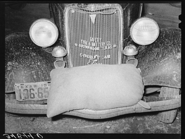 Sack of feed on bumper of automobile. Brownwood, Texas