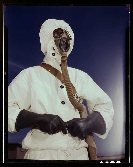 Sailor at the Naval Air Base wears the new type protective clothing and gas mask designed for use in chemical warfare, Corpus Christi, Texas. These uniforms are lighter than the old type