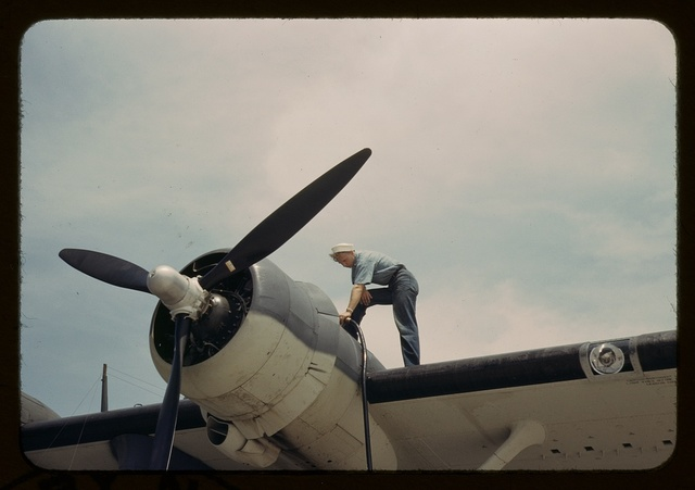 Sailor mechanic fueling a plane at the Naval Air Base, Corpus Christi, Texas