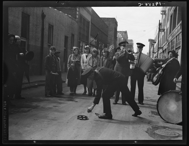 Salvation Army, San Francisco, California. Army contributes first to the tambourine (two dollars), outside contribution about seventy-five cents, all from drunks and the like