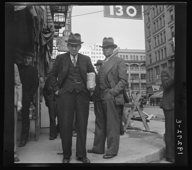 Salvation Army, San Francisco, California. Men pause a moment to watch, and then pass on